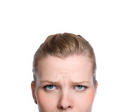 Shot of the upper part of an angry womans face. Close-up shot of the upper part of an angry womans face, Isolated on white Stock Photos