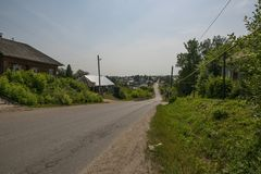 Shot of village road and some cottages in summer Stock Photos