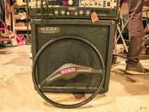 Shot of a vintage amplifier, a speaker and a Fiat steering wheels royalty free stock photos