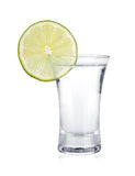 Shot of vodka and lime slice Stock Photos