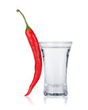 Shot of vodka and red hot chili pepper Royalty Free Stock Photography