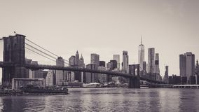 Panoramic view of lower Manhattan and Brooklyn bridge. The shot was taken from Dumbo district across the East river. The view shows the modern architecture in Royalty Free Stock Photo
