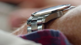 Shot of a watch on hand. A macro shot of a watch on a hand stock footage