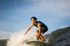 Longboard surfer rides towards the water camera Royalty Free Stock Photography