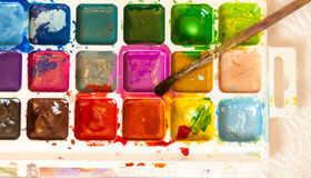Shot of watercolor palette with brush Royalty Free Stock Photography