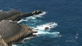 Shot of Waves Breaking onto Rocks. Atlantic ocean 4K stock video footage