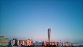 Turning Torso and Vastra Hamnen & x28;Western Harbour& x29; in Malmo, Sweden. A shot of Western Harbour are in Malmo, Sweden, during a summer sunset at around Royalty Free Stock Images