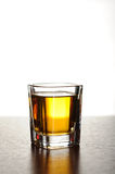 Shot of whiskey. On wooden table Royalty Free Stock Image