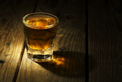 Shot of whiskey. On old wooden surface Royalty Free Stock Photo