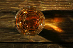 Shot of whiskey. On old wooden surface Royalty Free Stock Images