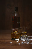 Shot of whiskey on old wooden surface Stock Photos