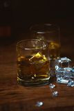 Shot of whiskey on old wooden surface Stock Photography