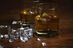 Shot of whiskey on old wooden surface Royalty Free Stock Photo