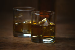 Shot of whiskey on old wooden surface Royalty Free Stock Photography