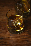 Shot of whiskey on old wooden surface Royalty Free Stock Image