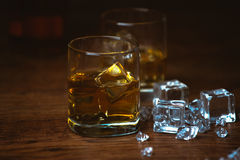Shot of whiskey on old wooden surface Royalty Free Stock Images