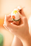 shot of woman drawing flower on easter egg Royalty Free Stock Photography