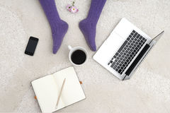Shot of woman feet, laptop, coffee and notebook on the white car Royalty Free Stock Image