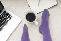 Shot of woman feet, laptop, coffee and notebook on the white car Stock Photos