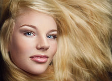 Shot of young beautiful girl with long blond hair Stock Image