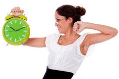 Shot of a Young business woman holding clock Royalty Free Stock Photo
