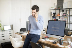 Young professional man in the office Stock Photography