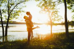 Shot of a young couple bonding trough walking in the nature. Beautiful young couple are walking and laughing in nature royalty free stock photos