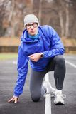 Shot of a young handsome professional runner looking at camera. Royalty Free Stock Photo