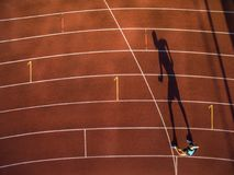 Shot of a young male athlete training on a race track. Sprinter running on athletics tracks