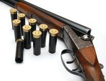 Shotgun. Isolated shot of shotgun with ammunition Stock Image