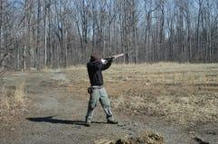 Shotgun. Shooting skeet with a 20 gauge shotgun stock photo