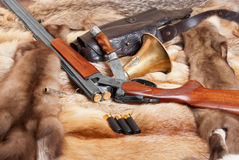 Shotgun. And hunting belongings on background of the fur Royalty Free Stock Photo