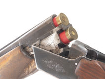 Shotgun. And ammunition on white dackground Stock Images
