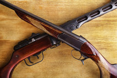 Shotgun with assault rifle Stock Photo