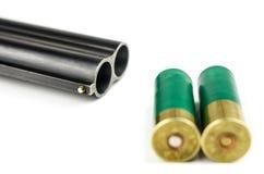 Shotgun. Barrel shotgun and cartridges on a white background Royalty Free Stock Photos
