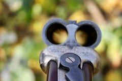 Shotgun barrel. Looking down the barrel of a twelve-bore shot gun on a Shoot in Norfolk Stock Photography