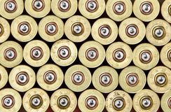 Shotgun Cartridges. Brass colored cap background Stock Photography