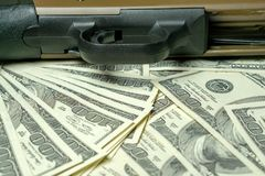 Shotgun on dollars. Concept for crime, global arms trade, weapons sale. Illegal hunting, poaching.  royalty free stock photos