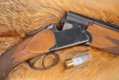 Shotgun on fur. Shotgun with shell on fur Royalty Free Stock Photos