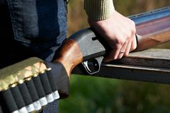 Shotgun in hand hunter Stock Images