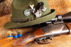 Shotgun and hunting hat Stock Photos