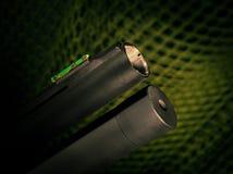 Shotgun muzzle. Muzzle and tube magazine on a black shotgun Stock Photo