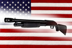 Shotgun Police Pump Action Made in USA with American Flag Royalty Free Stock Photos
