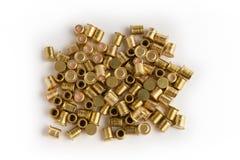Shotgun primers on white Stock Photo