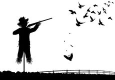Shotgun scarecrow. Editable vector silhouette of a scarecrow shooting pigeons with a shotgun Royalty Free Stock Photos