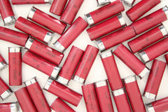 Shotgun Shells. A carpet of 12 gauge shotgun shells lying on a white background stock photography