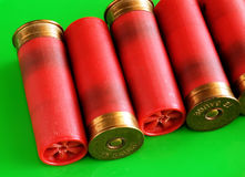 Shotgun shells. On green background Royalty Free Stock Images