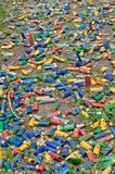 Shotgun shells on the ground. A lot of utilized shotgun collets are heaped on the soil after shooting Royalty Free Stock Photos