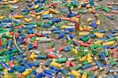 Shotgun shells on the ground. A lot of utilized shotgun collets are heaped on the soil after shooting Royalty Free Stock Photography