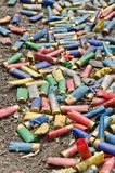 Shotgun shells on the ground. A lot of utilized shotgun collets are heaped on the soil after shooting Stock Photos